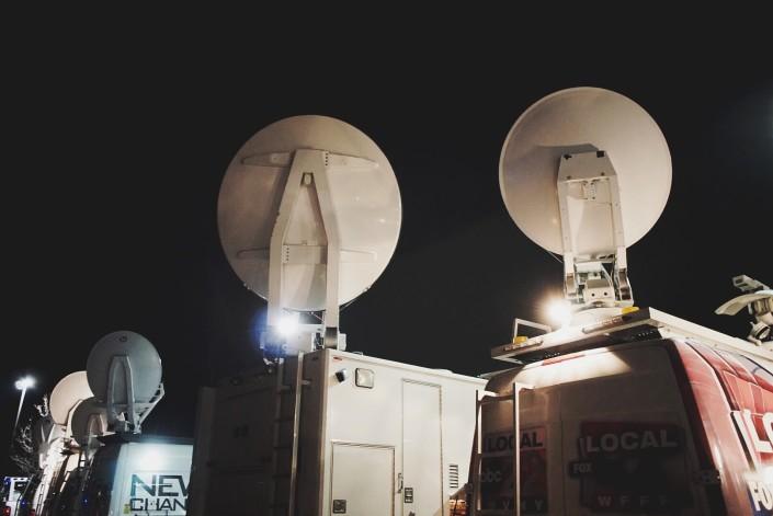 Satellite trucks at Saint Anselm College - DemDebate